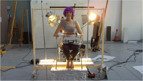 Figure 1: Image taken in the styling workshop where students were asked to create a setting using a model, props and lighting, which they then drew.