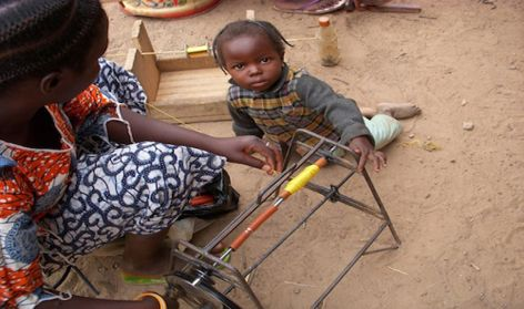 Mother and child in weaving atelier,