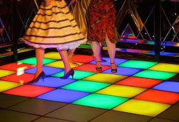 Dance floor with coloured chequerboard and 50s dresses from Our Dancing Feet community project