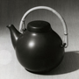 'Black stoneware teapot designed by Ulla Procope, manufactured by Arabia' (1950s). Catalogue number: DCA-30-1-TAB-CE-IL-8. Design Council Archive / University of Brighton Design Archives.