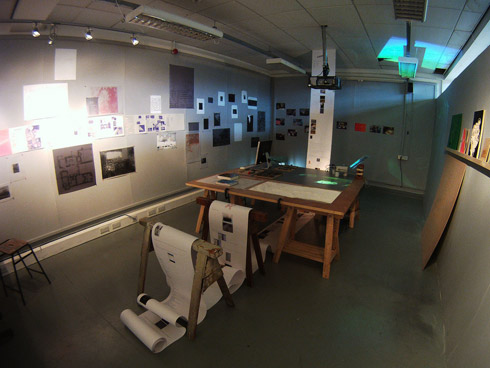Figure 12. Exhibition view – shows blog-print falling from the ceiling. Photo: Adam Cluley