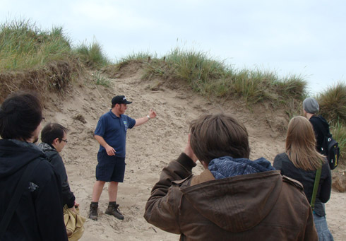Figure 1: Students from the Summer Phase of the project met with the West Sands ranger to find out more about the coastal defences in St. Andrews, and to gather vital research information and imagery to inform their prototype application.