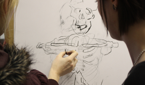 Medical student and Craft student collaborating on drawing during the Human Body Form module 2012.