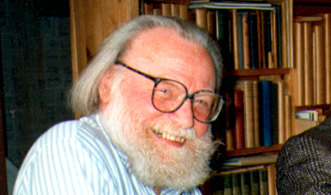 Portrait of Ray Watkinson beside his library