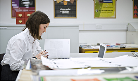 Leah Armstrong working in the University of Brighton Design Archives