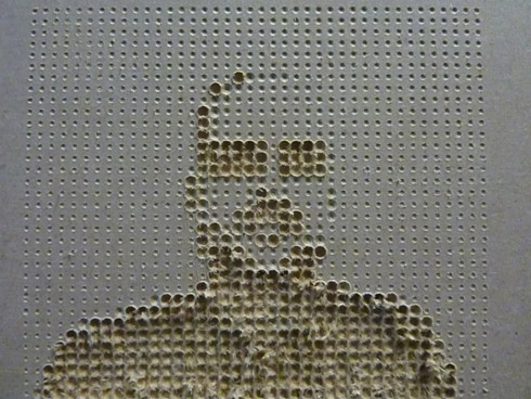 Figure 8. Portrait of Matthew using Processing code to vary the pressure of a 3mm drill bit in MDF. Photo: Steffi Hußlein