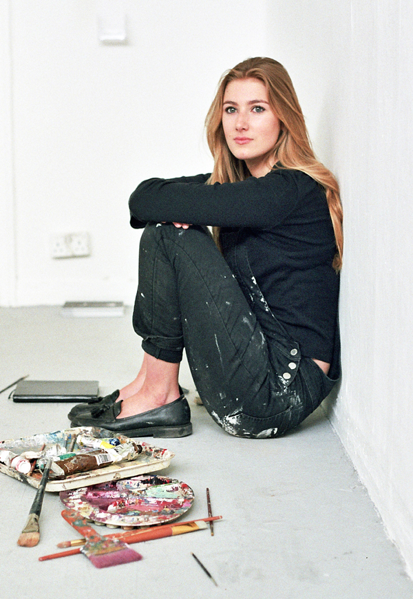 Photograph of portrait artist Sophie Williams sitting in studio
