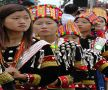 Young Kachin wearing Lhaovo: (Lawngwaw) dress at the manau festival, Shatapru, Kachin State, Myanmar, January 2011